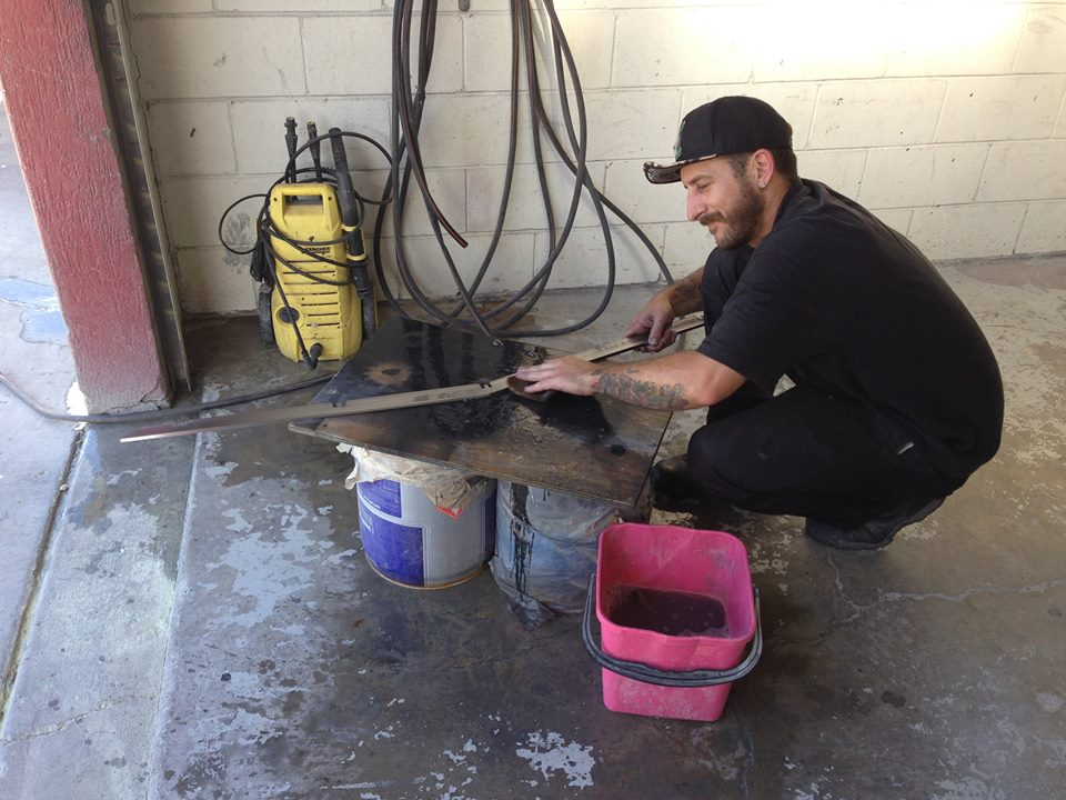 Kieran wet sanding an EH grill trim piece. Finer grades of wet and dry sand paper are used resulting in a shiny finish even before heading to the polishing wheel.
