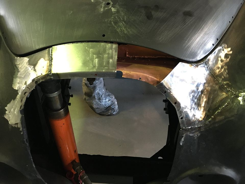 The rust patches were then welded in place. Note the copper-based primer that protects the inner surfaces from rust without interfering with the welding process.