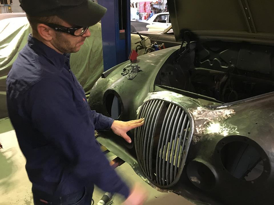 After he is happy with the repairs, Roland trial fits the grill to ensure it fits correctly. This is an important step as you do not want to be making adjustments after the car is painted.