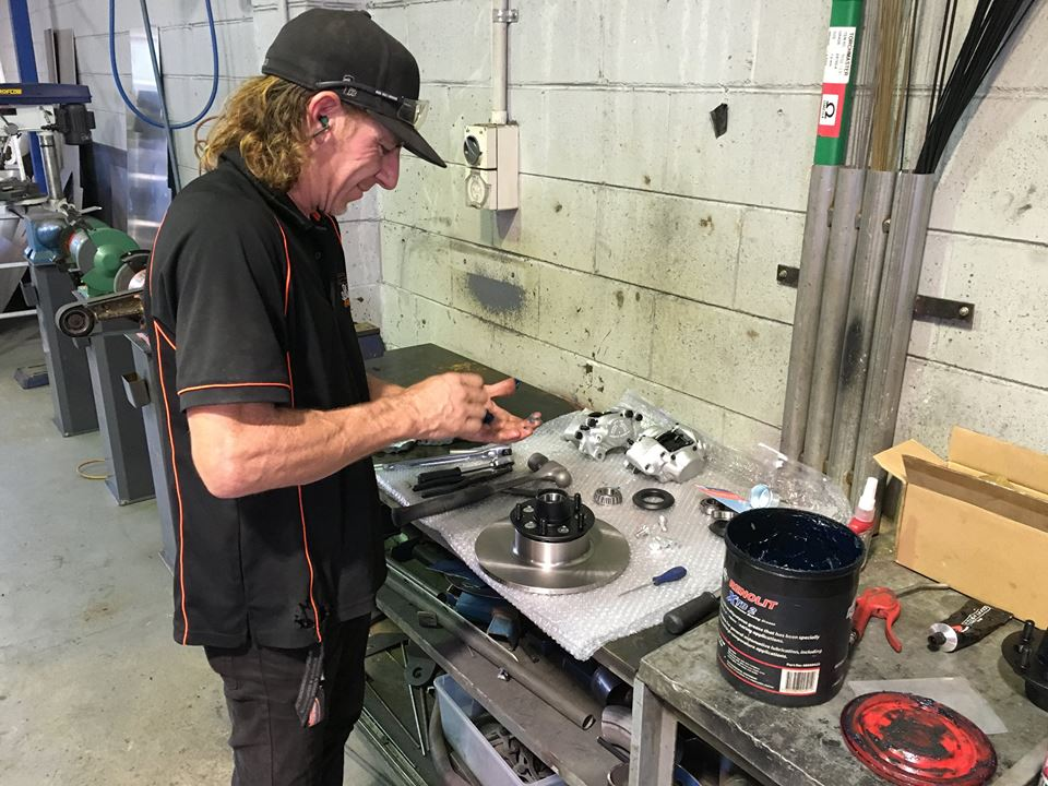 Andrew re-builds the front brakes.