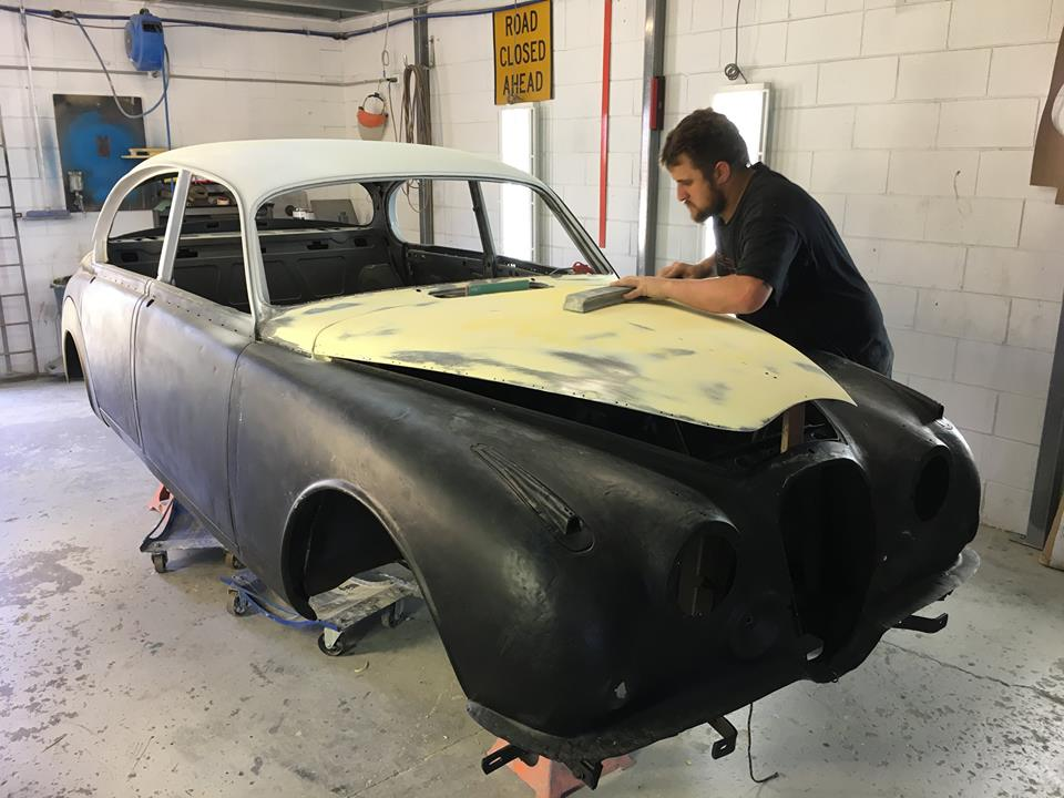 Ben is working on the Mk II Jag body work.