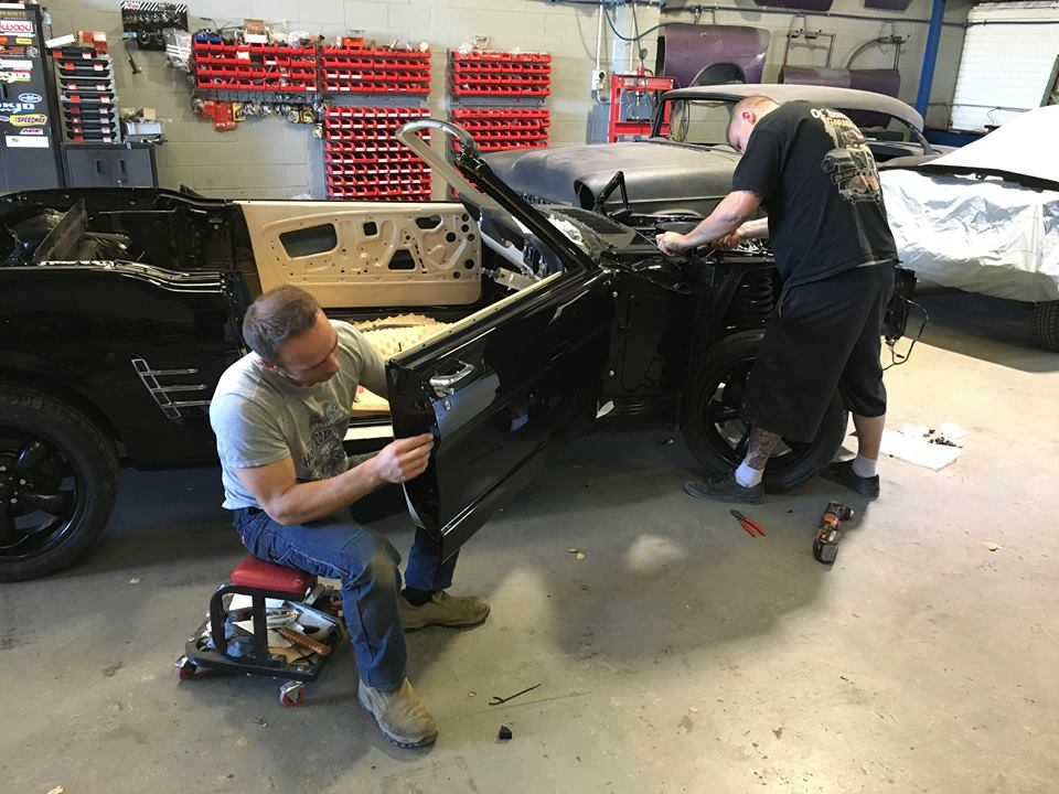 Tim and Roland are assembling the '66 Mustang Convertible.