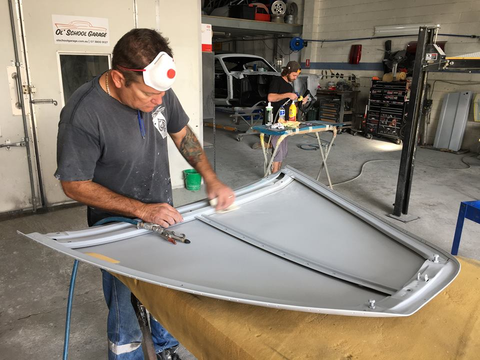 Andrew preps the underside of the '63 Jaguar Mk II bonnet ready for first colour. Kane is in the background polishing the last of the painted parts for the '66 Mustang Convertible.