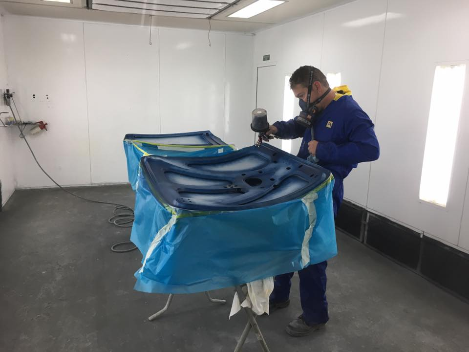 Andrew applies the first colour to the underside of the boot lid and bonnet.