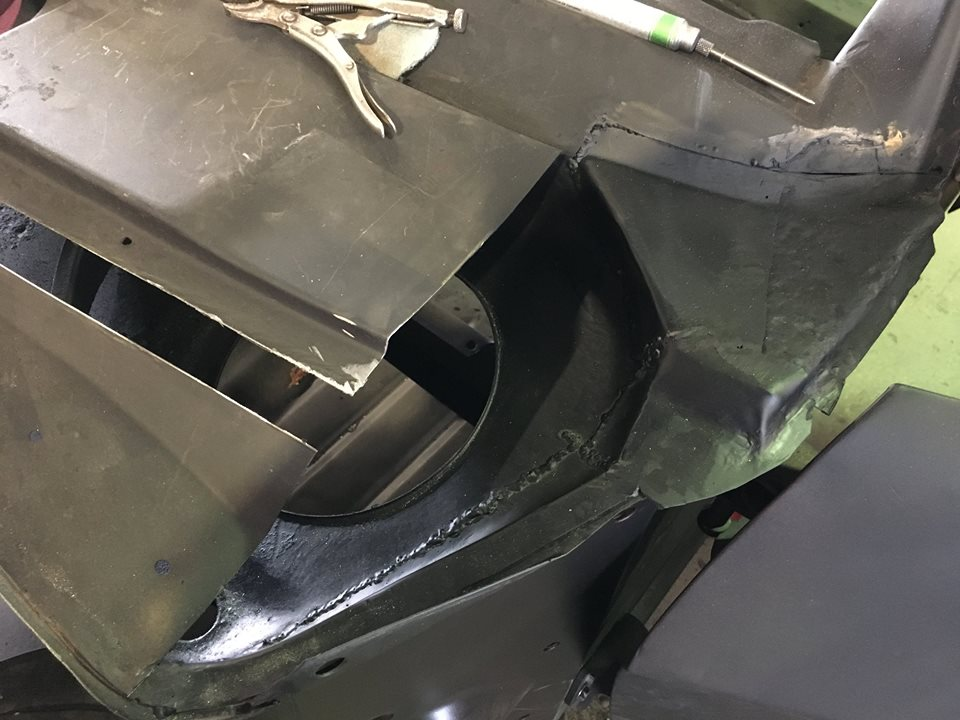 This photo shows the inner skin after it has been repaired. The inner surfaces receive a protective coat of primer to protect the metal.
