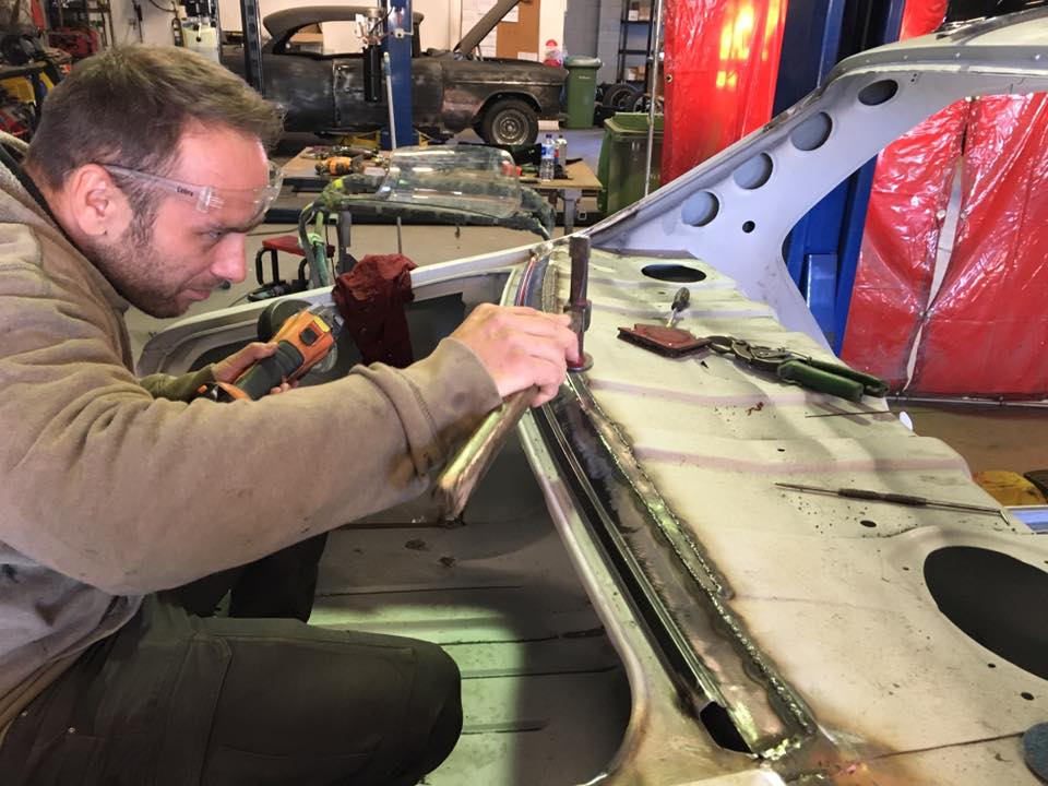 Roland repairs the rear windscreen surround on our other HQ in the fab shop.