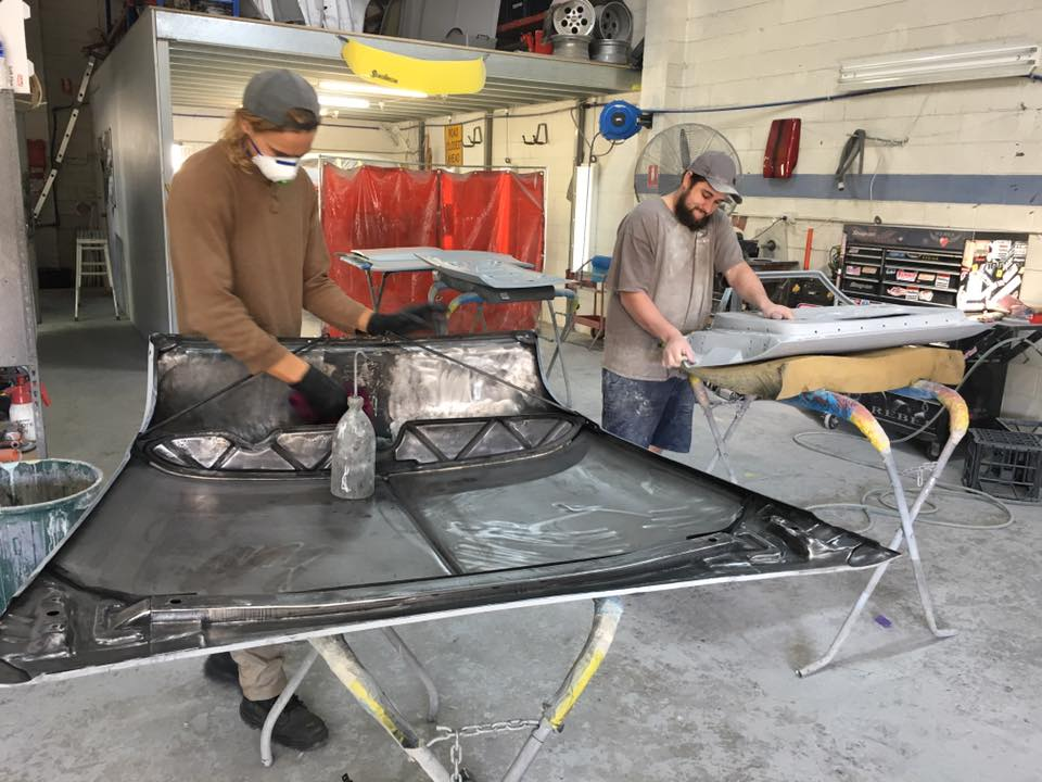 Henry is prepping the underside of my '55 Chev 2-door Hardtop ready for a protective coat of epoxy primer.
