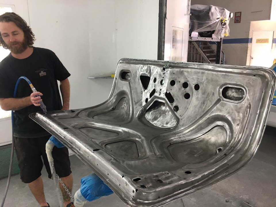 Kane preps the underside of the boot lid ready for a coat of protective epoxy primer.