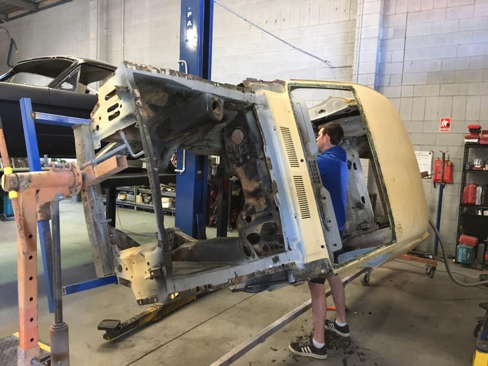 Shane strips the factory sound deadener off the '67 Mustang. It needs to be removed before the car is sand blasted later this week.