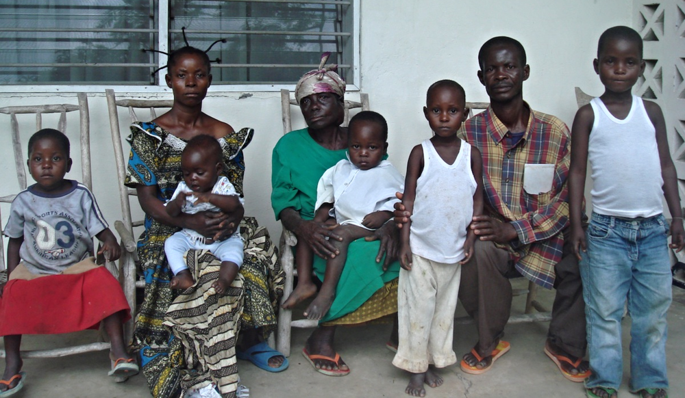 Makolo, his wife, mother and five of the nine children