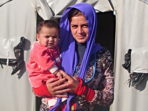 Yazidi mother and her infant, born shortly after reaching the camp
