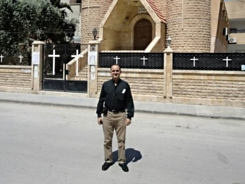 Rev. Salam Hanna, another Presbyterian pastor in Syria, visiting the Church in Hasakeh which was founded and built by Yacoub and Mathild's father
