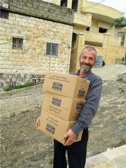 Bassam helps bring food to other displaced families whose heartbreak he understands only too well
