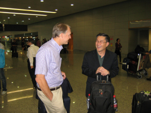 Bruce and Peter awaiting luggage in the Shanghai airport