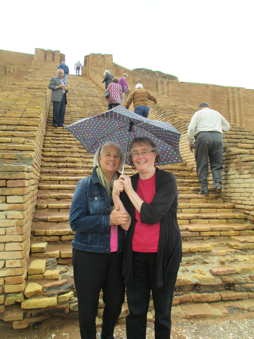 Roomies Babs and Julie with handy-for-the-day umbrella on the great staircase of the ziggurat.