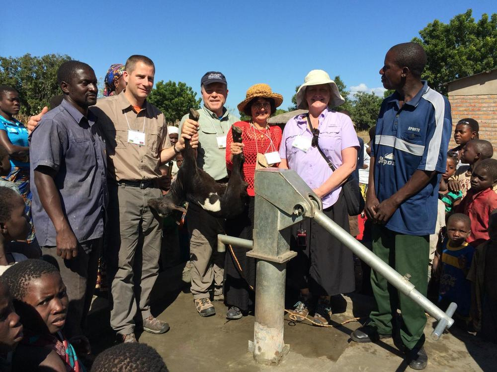 Celebrating one of the two new wells at the Chikoti church.