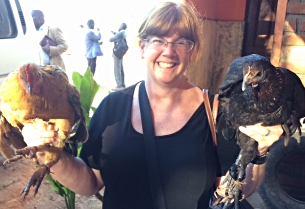 Heidi Meadows holding gifts of chickens!