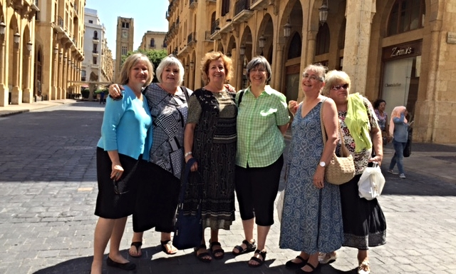 Louise Westfall, Marilyn Borst, Patti Gatzke, Kate Kotfila, Julie Burgess and Meryle Gaston gather together in front of the clocktower on Parliament Square, Beirut.