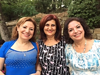 Ghada from Damascus flanked by her sisters-in-law.