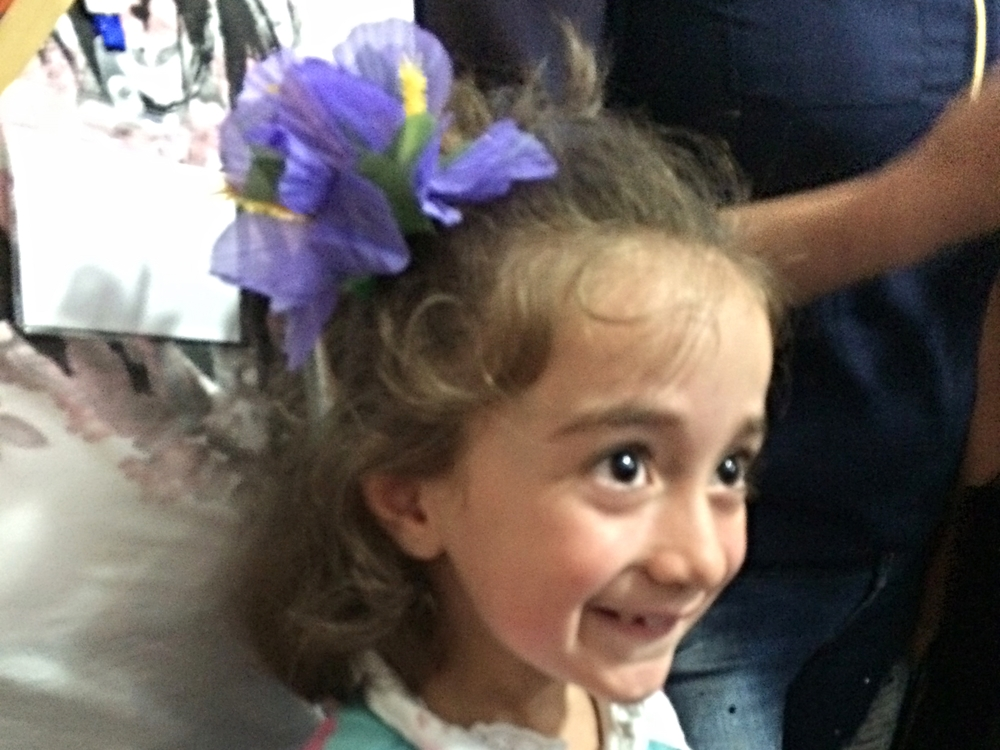Lutha Nseir of Aleppo models her new floral hair clip.