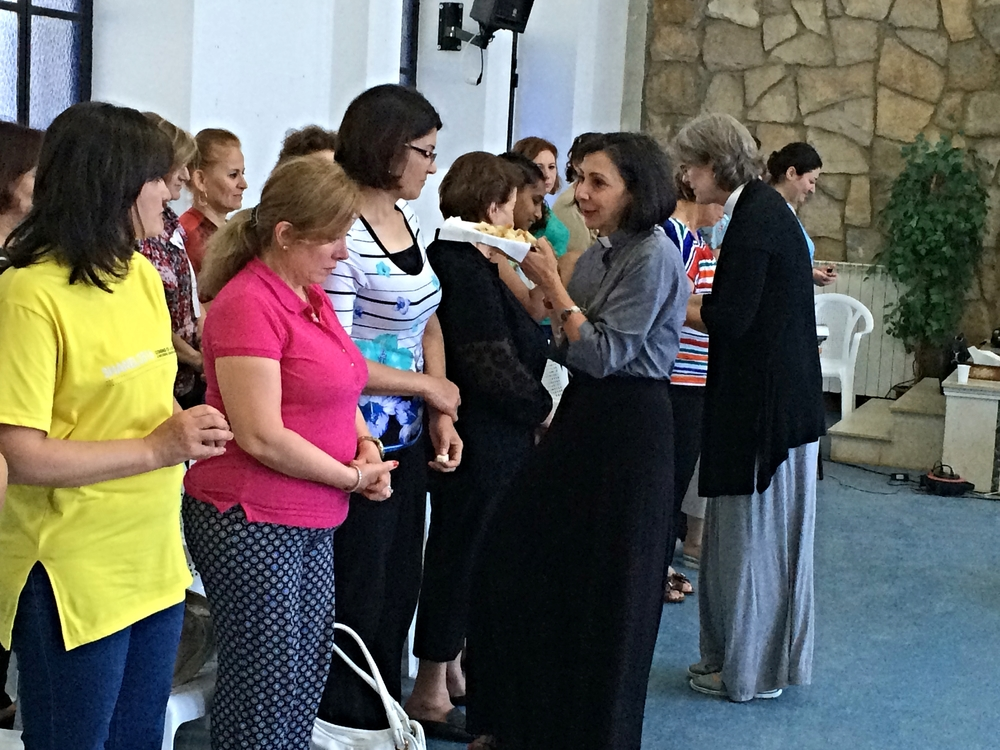 Lisa and Toby serve the elements to the women at the conference. Wafa, wife of the pastor from the Damascus church, is in the pink top.