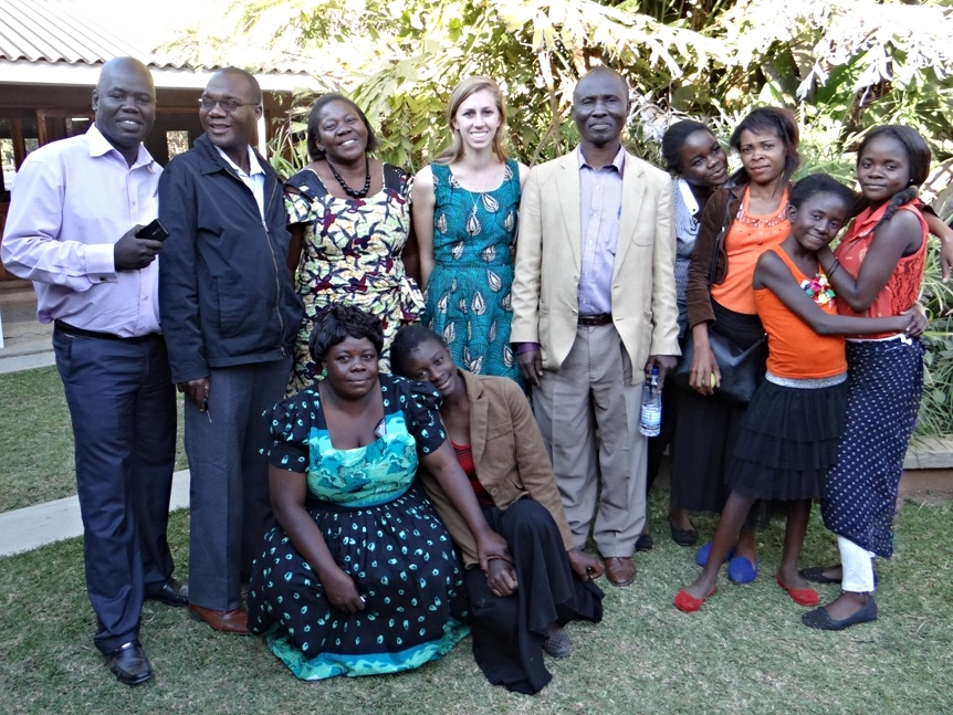 Becca, a 2014-2015 YAV, surrounded by various YAV Zambia supervisors and host family members