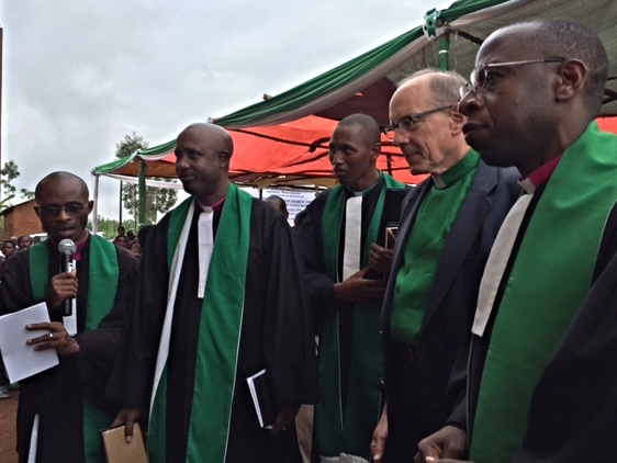 Rob and Rwandan pastors preparing to cut the ribbon and enter the Karangara Church