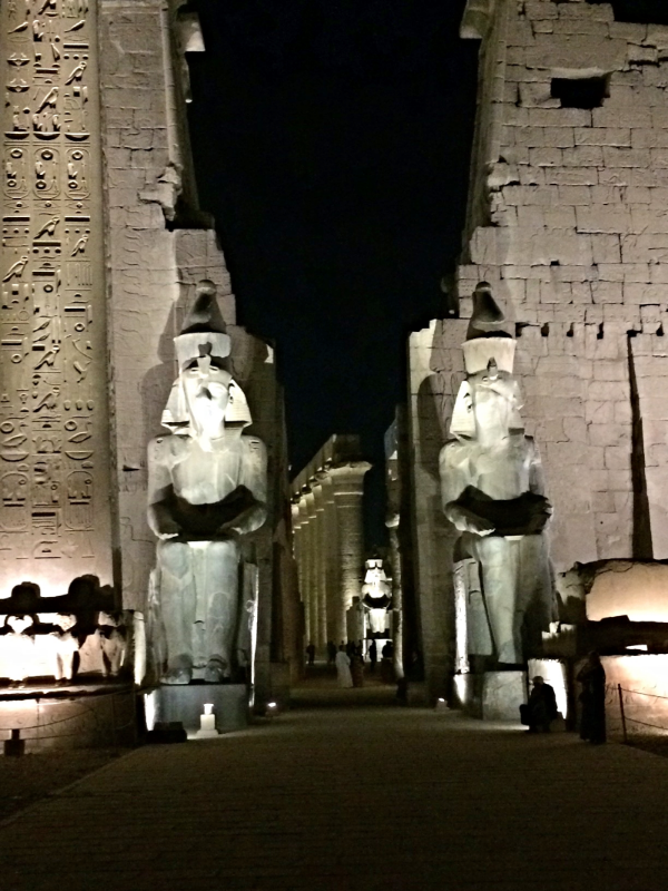 "This is the entrance to the Luxor Temple, one of two temples in downtown Luxor that are connected by ""Sphinx Road,"" a mile long road lined with Sphinx statues every 10 feet or so."