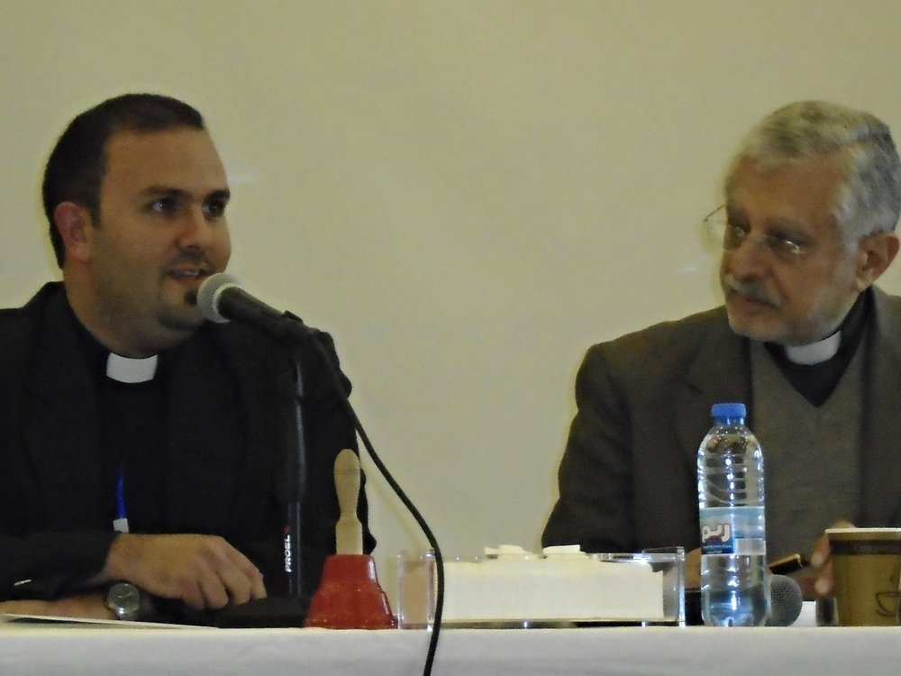 Rev. Mofid Karajieli, pastor of the church in Homs, and Rev. Adeeb Awad, vice moderator of NESSL and today's meeting moderator.