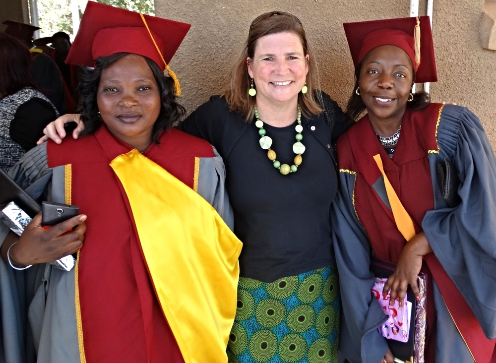 Sherri with new graduates Mary Limula and Shingi Masunda