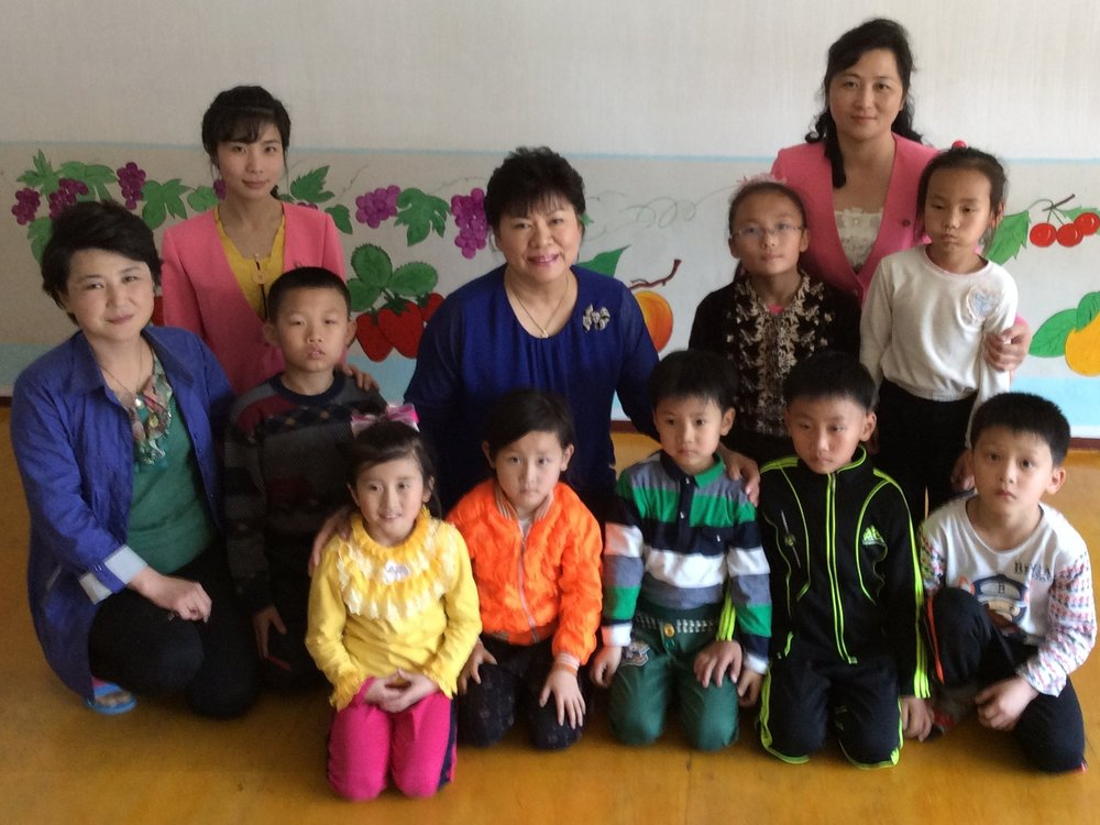 Sue with staff members and children at the School for Mentally Impaired Children in Pyongyang