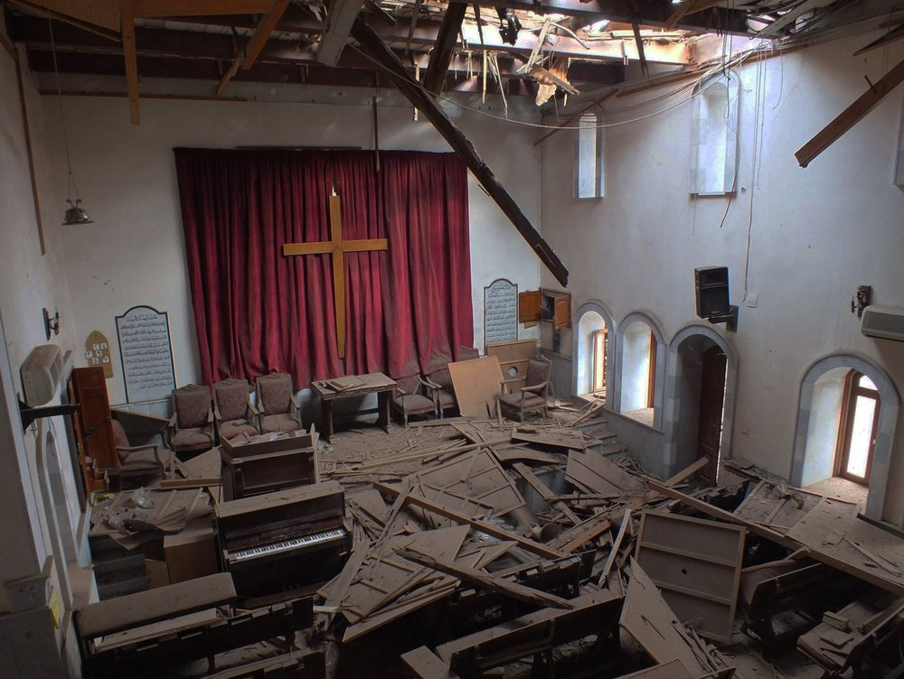 The photo was taken from from the balcony of the Presbyterian Church in Homs, Syria, after it sustained a rocket or mortar attack.