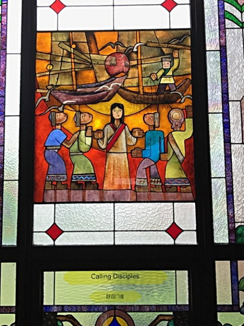 Stained glass from inside Dushu Lake Church. It incorporates the colors and designs from some of the Chinese minority ethnic groups to portray the ecumenical nature of the gospel.