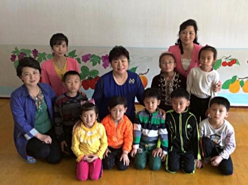 Sue Kinsler (center) in North Korea.