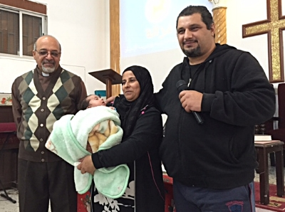 Pastor Amir of Tyre with Maged, his wife and baby Amir