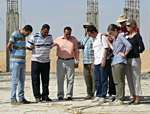 2016 Outreach team prays with Rev. (soon to be) Medhat, fourth from right, standing in his land grant church (El Sadat City Church) under construction.