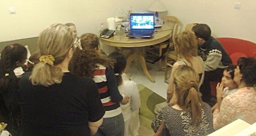 An actual house church in Iran gathered around a laptop watching the show that is depicted in the photo below.