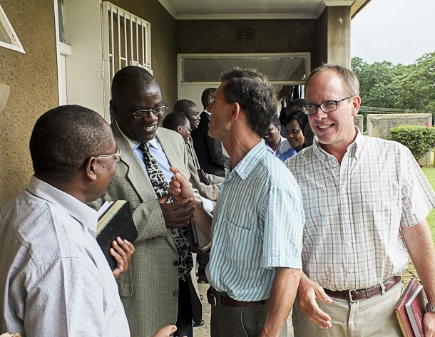 Dustin enjoys fellowship with Justo Mwale University faculty members Dr. Soko, Dr. Edwin Zulu, and Dr. Wynand Retief                    photo by Johanneke Kroesbergen