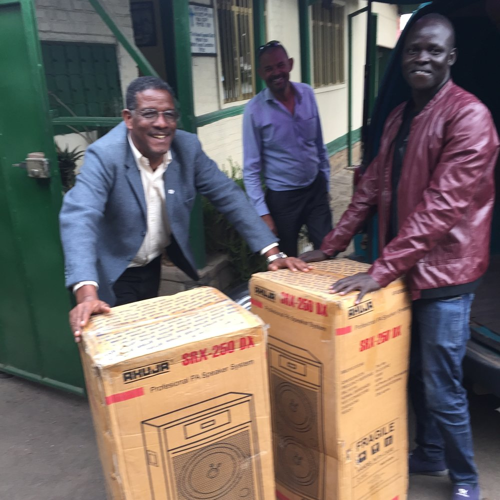 Loading the instruments in Addis Ababa. Mr. Petros Tsanu, Projects Director for the Bethel Synods of the Mekane Yesus Church (shown left) arranged for the purchase of these instruments on our behalf.