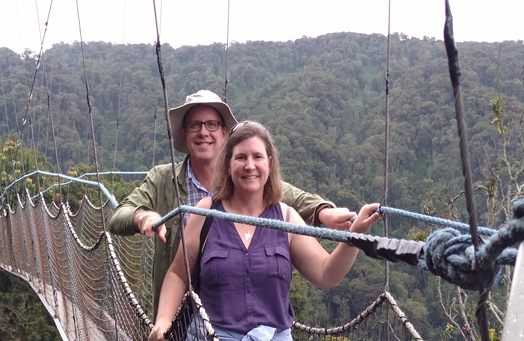 "Enjoying Rwanda's lush Nyungwe Forest National Park, Dustin and Sherri brave the ""canopy walk."""
