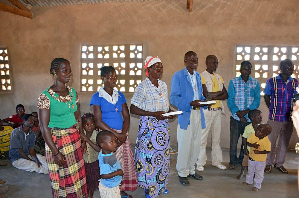 Gifts of Bibles and cross necklaces to leaders at Madzimaera Church