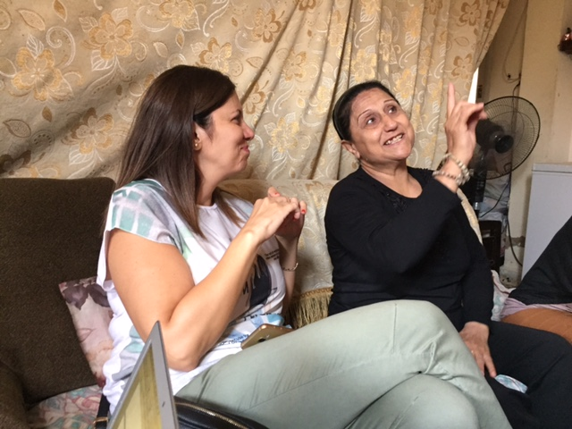 Grace Boustani of Our Lady Dispensary bringing smiles in Beirut to an Iraqi family, refugees who have fled three times since 2003.