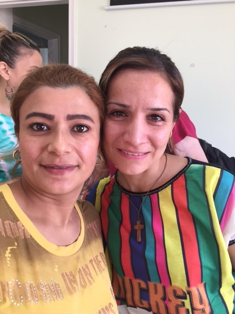 Syrian and Iraqi sisters marked with love.
