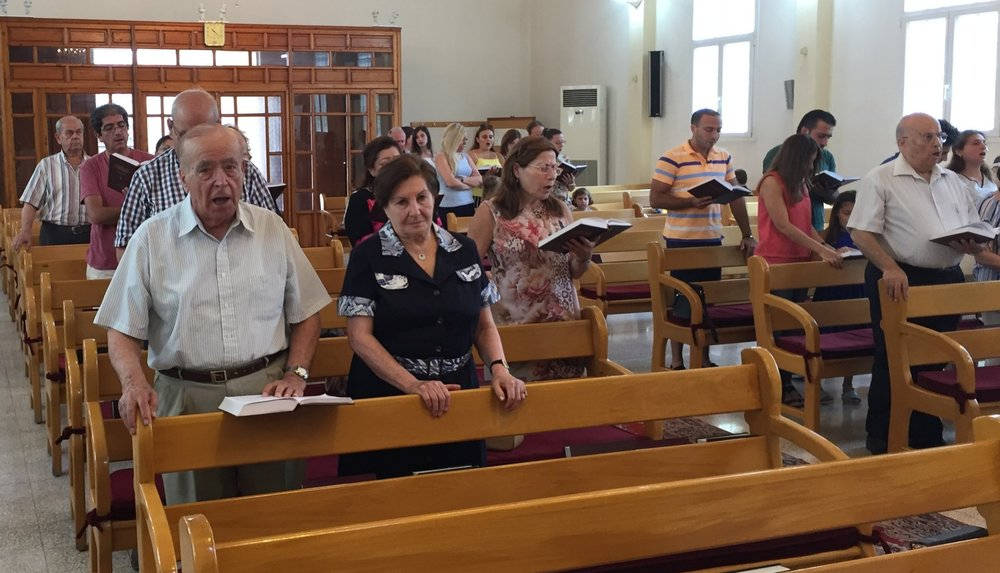 Congregation members in worship in Tripoli.