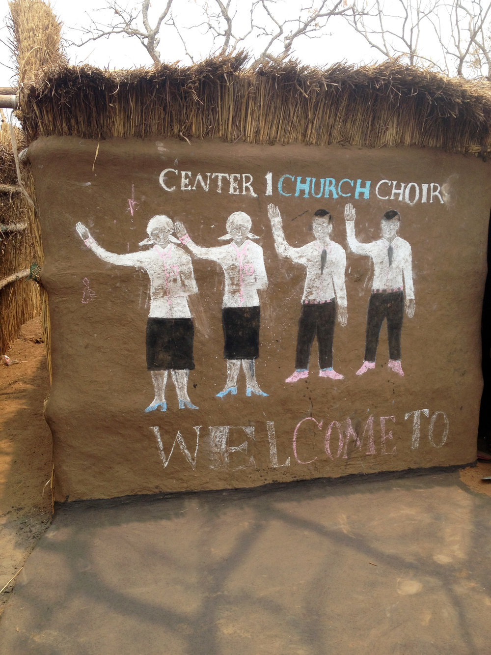 Chalk drawing on the youth choir hut in refugee camp.