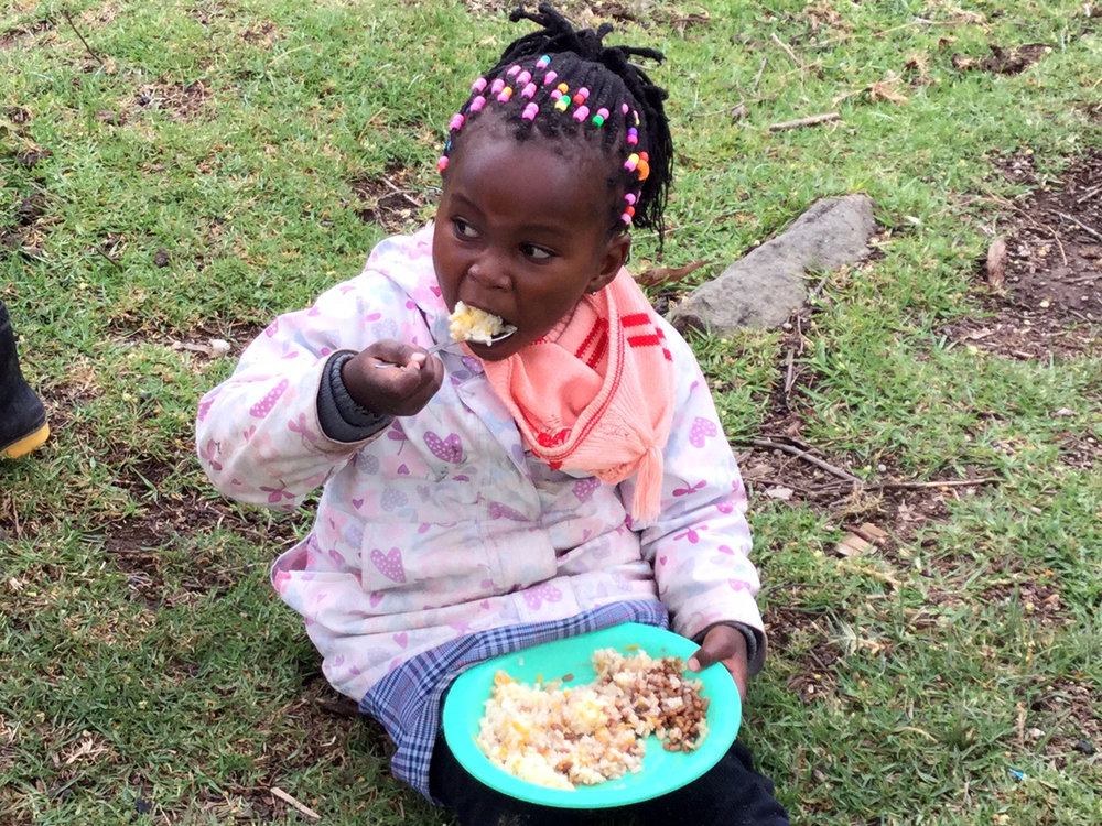 Kinamba-girl-enjoying-food-2017.JPG