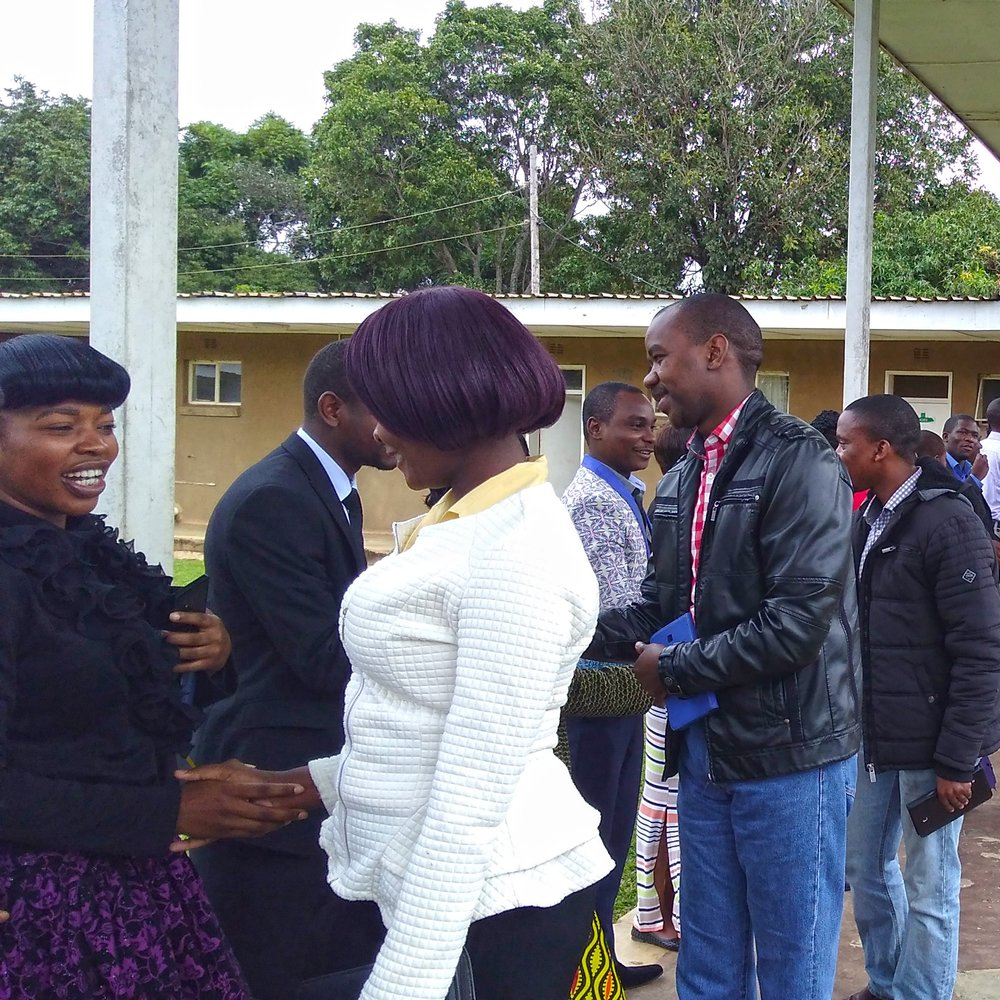 Justo Mwale theological students shaking hands and enjoying fellowship after Friday morning chapel.