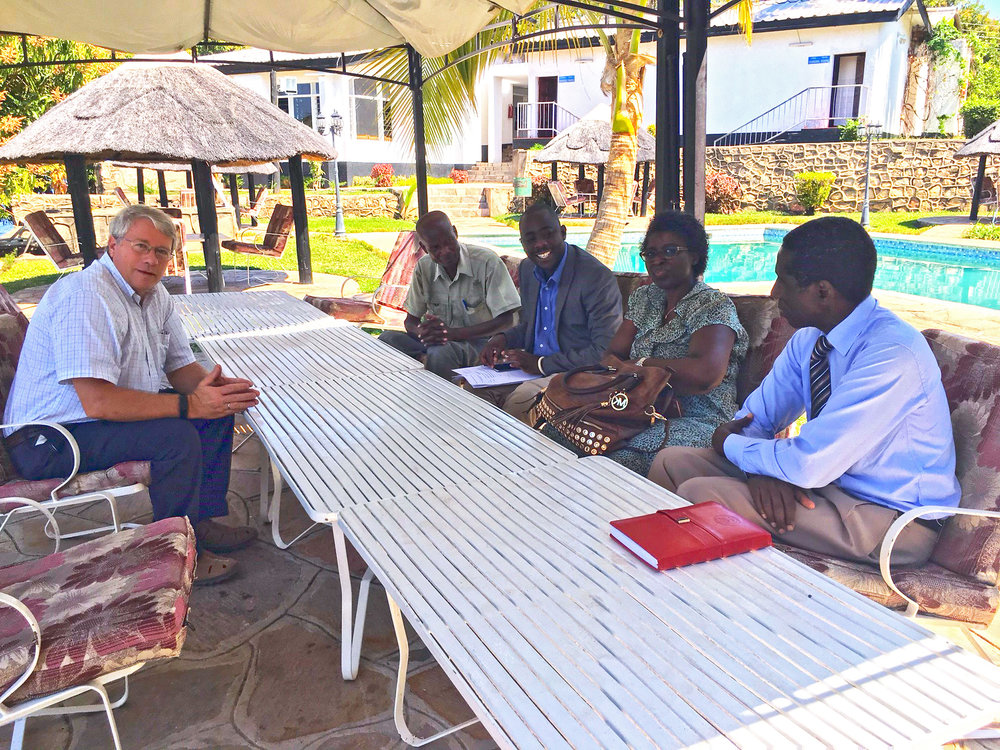 Ebralie and Frank meeting with Mr. Simamba (director), Mr. Hachitapika, (chairman of the board), and Mr. Walueita, district fisheries department.