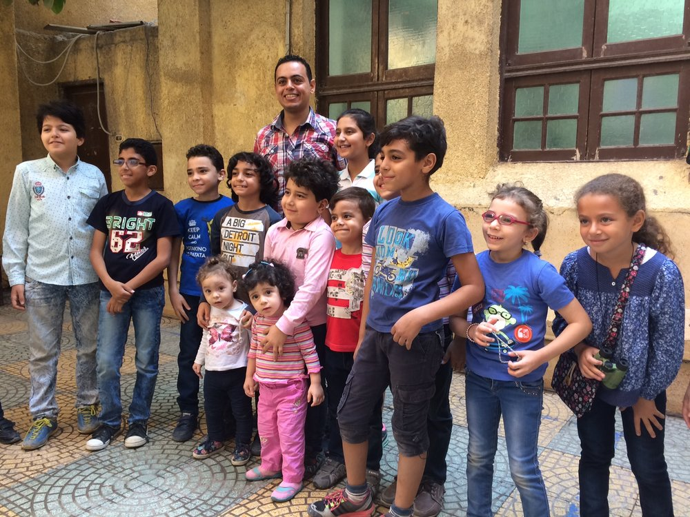"Precious children in the Zagazig Church Sunday School program with their teacher, David. Said Pastor Wael, ""they are the future of this church."""