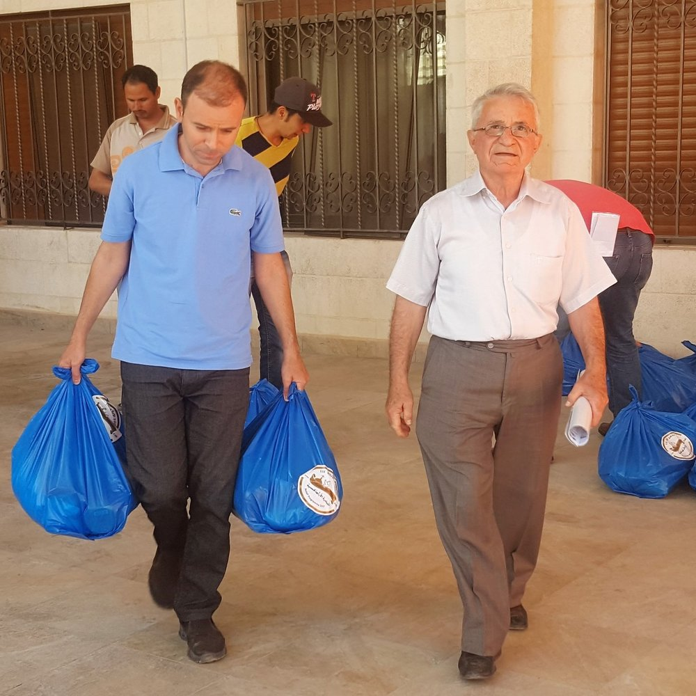 Refugee-IDP-Appeal-November-2017-men-with-bags.jpg